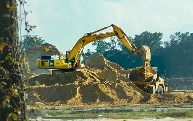 OCT 14, 2015 - Excavator at Bass Pro Shops construction site, Gainesville, Florida/photonews247.com