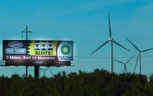 OCT 10, 2015 - Exit 72 Mendota billboard with Cindys Home Cooking, Slots and BP Gas and Showers with Wind Turbines/photonews247.com