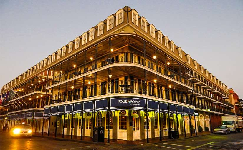 SEPT 14, 2015 - Four Point Hotel by Sheraton with taxie driving on Bourbon Street, New Orleans, LA/photonews247.com