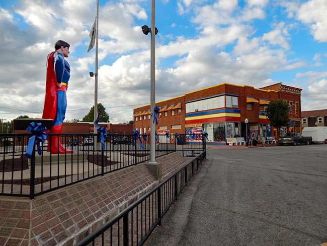 OCT 6, 2015 - Giant Superman statue in town square looking down Market Street in Metropolis, Illinois/photonews247.com