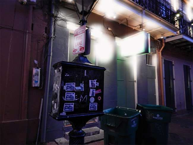 SEPT 15, 2015 - Green metal payphone box on lamp post next to Tropical Isle on Bourbon Street, New Orleans, LA/photonews247.com