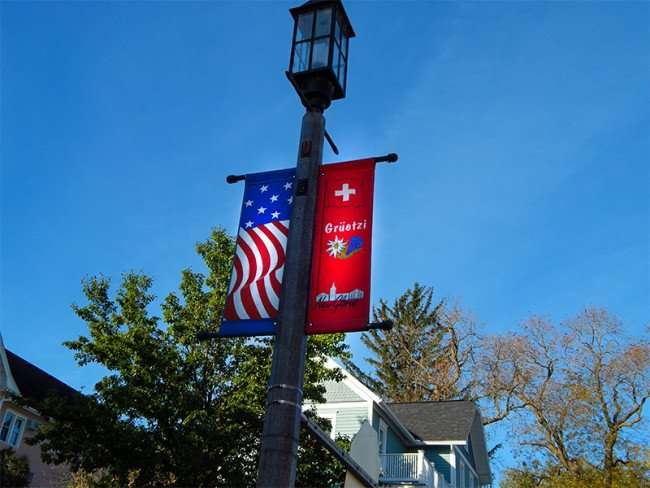 OCT 10, 2015 - Gruetzi, a Swiss greetings on banners on streets lamps in New Glarus, WI