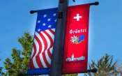 OCT 10, 2015 - Gruetzi, a Swiss greetings on banners on streets of New Glarus, WI/photonews247.com