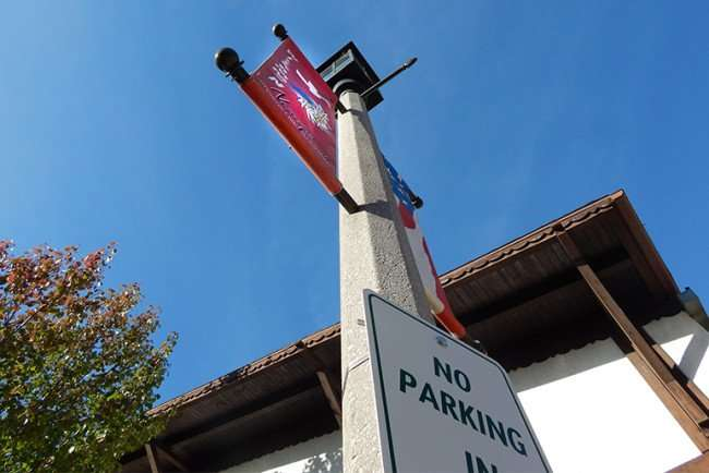 OCT 10, 2015 - Gruetzi, a Swiss greetings on banners on streets posts in New Glarus, WI/photonews247.com