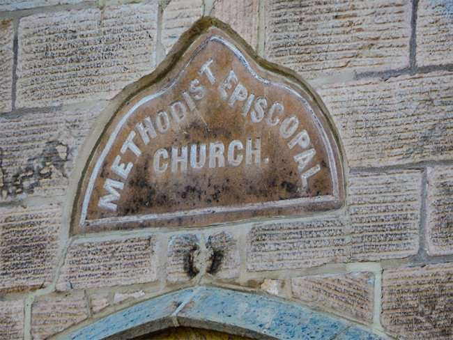 OCT 10, 2015 - Historic signage engraved above door at Methodist Episcopal Church in Mineral Point, WI/photonews247.com