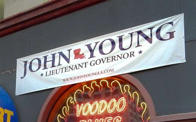 SEPT 14, 2015 - John Young Lt Gov New Orleans on banner above convenience store on Canal Street/photonews247.com