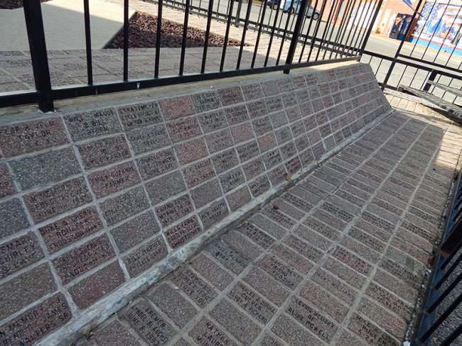 OCT 6, 2015 - Memorial and sponsored bricks cemented in along side of Superman statue in Metropolis/photonews247.com