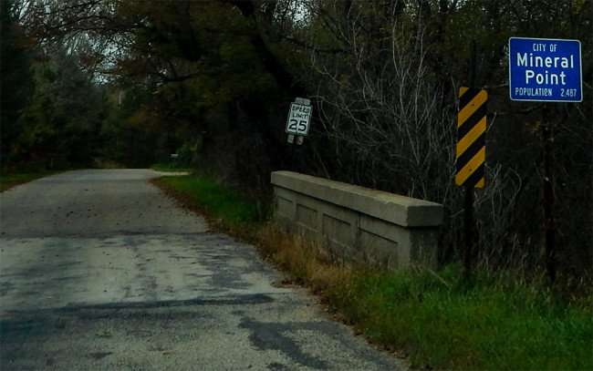OCT 8, 2015 - Mineral Point pop 2487 etched on sign at bridge along Darlington Road/photonews247.com
