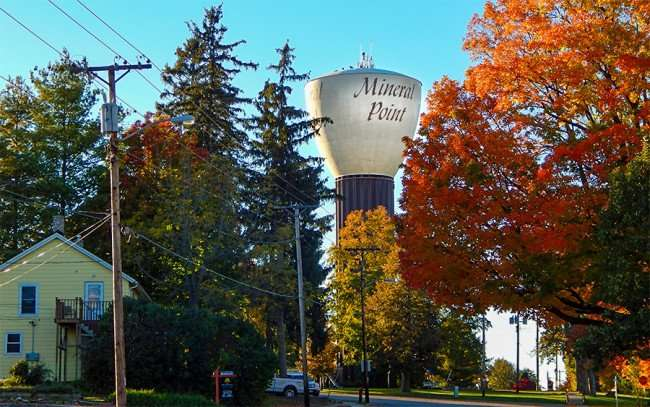 OCT 10, 2015 - Mineral Point water tower with trees turning colors in October 2015/photonews247.com