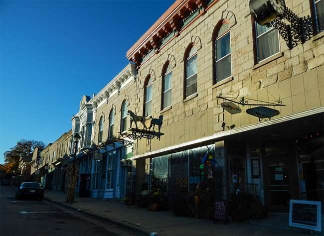 OCT 10, 2015 - Old Department Store Gundy and Gray with Pointer Dog statue and clock on building on High St, Mineral Point/photonews247.com