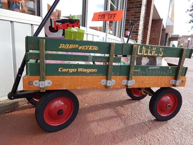 OCT 6, 2015 - Old green Radio Flyer Cargo Wagon at Lillies Hallmark on Market St, Metropolis, Illinois/photonews247.com