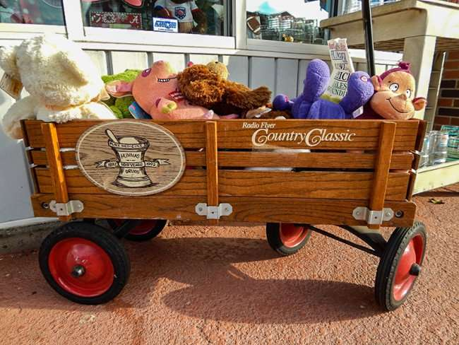 OCT 6, 2015 - Old wooden Radio Flyer Country Classic wagon filled with stuffed animals at Lilie's Hallmark on Market St in Metropolis, IL/photonews247.com
