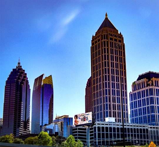 OCT 14, 2015 - One Atlantic Center building is the tallest skyscraper (820 ft) in the photo that sitting left from the Regions building in Atlanta, Georgia/photonews247.com
