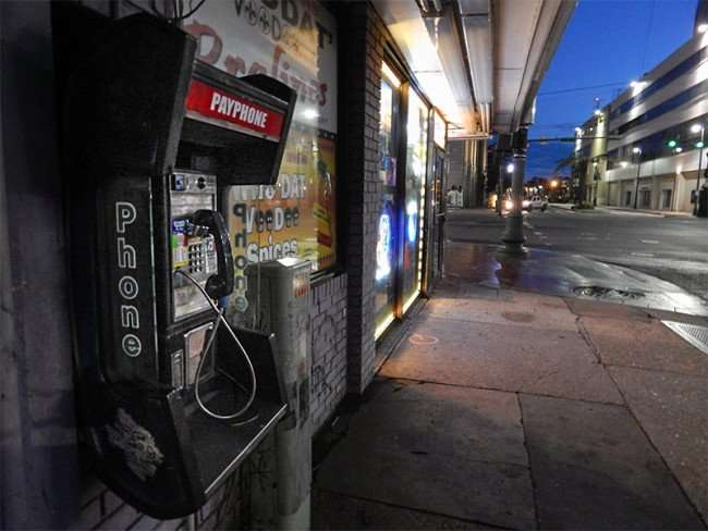 NOV 19, 2015 - Payphone at the corner of Tchoupitoulas St and Canal St in New Orleans, LA/photonews247.com