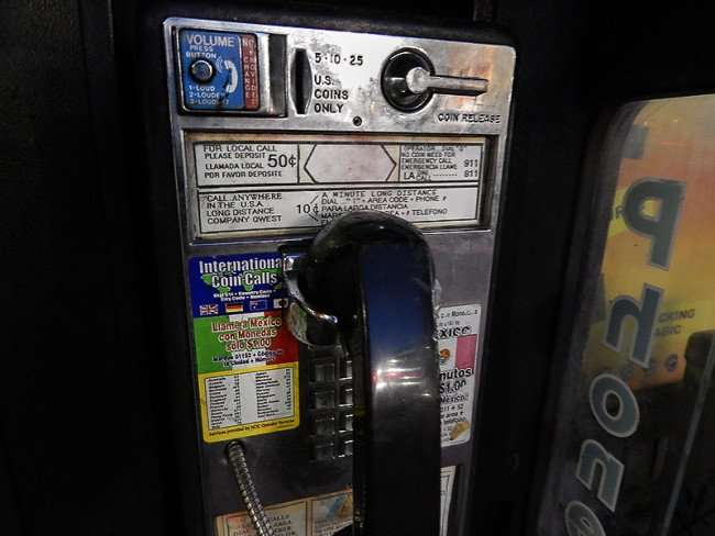 NOV 19, 2015 - Payphone (close up) 50 cents for locals calls at the corner of Tchoupitoulas St and Canal St in New Orleans, LA/photonews247.com