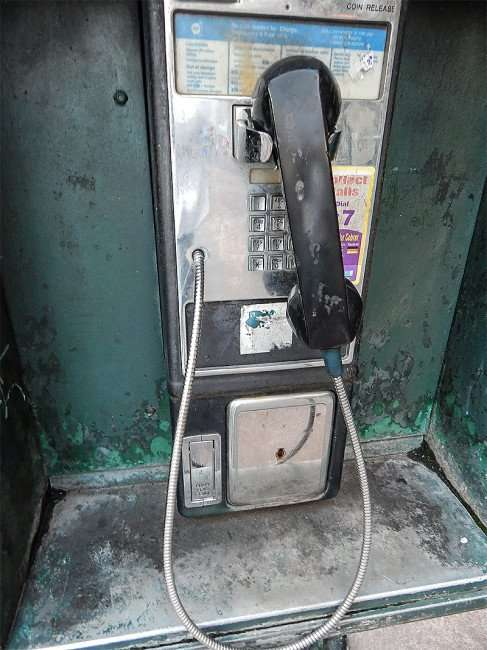 SEPT 15, 2015 - Payphone on Canal Street in New Orleans, LA/photonews247.com