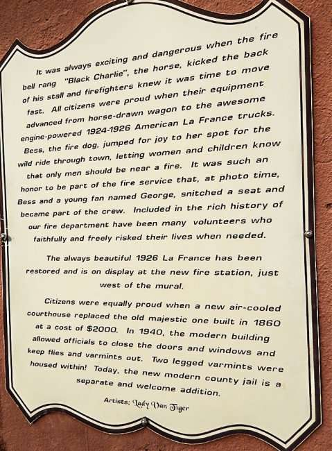 OCT 6, 2015 - Plaque next to mural by Lady Van Tiger with details about early days of Fire Rescue in Metropolis, IL/photonews247.com