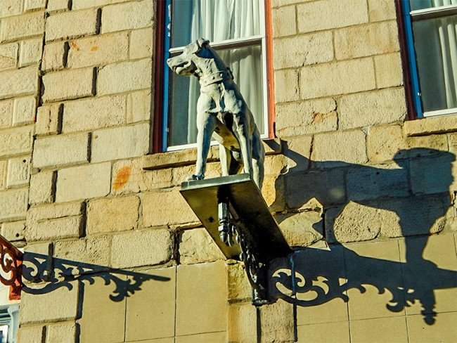 OCT 10, 2015 - Pointer Dog statue on stand on old Gundry & Gray department store, High St, Mineral Point/photonews247.com