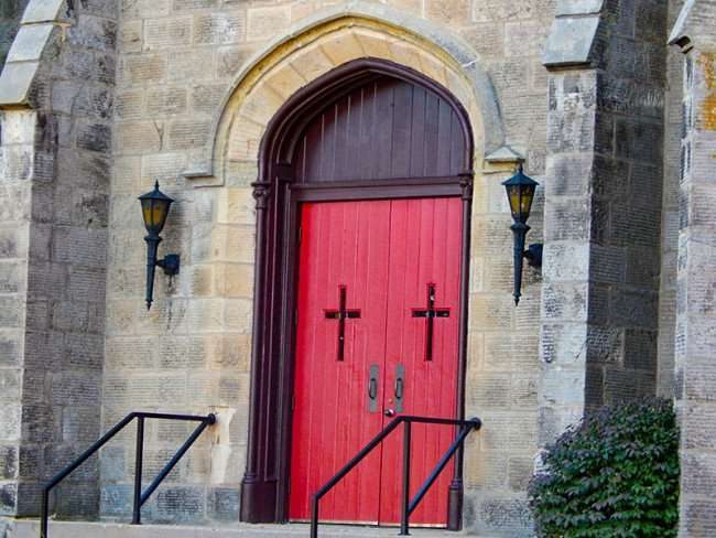 OCT 10, 2015 - Red front wooden doors at Trinity Church Episcopal Parish, Mineral Point, WI/photonews247.com