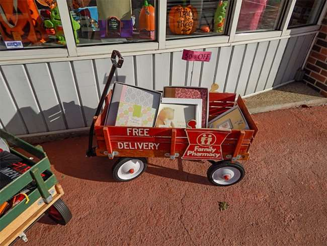 OCT 6, 2015 - Red wagon on sidewalk in front of Lilies Hallmark on Market St in Metropolis, Illiniois/photonews247.com