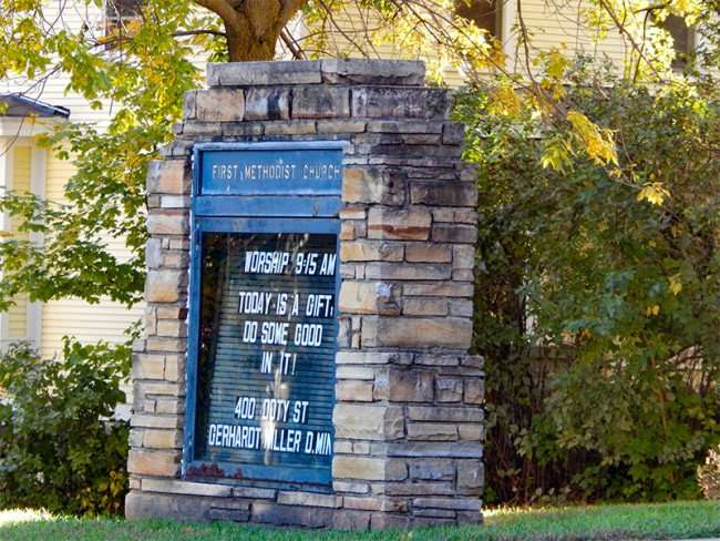 OCT 10, 2015 - Sign on lawn with worship times at First Methodist Church, Mineral Point, WI/photonews247.com