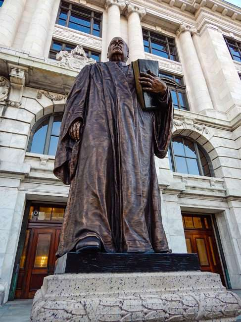 SEPT 14, 2015 - Statue of Edward Douglas White Chief Justice of Louisiana holding book on Royal Street, New Orleans, LA/photonews247.com