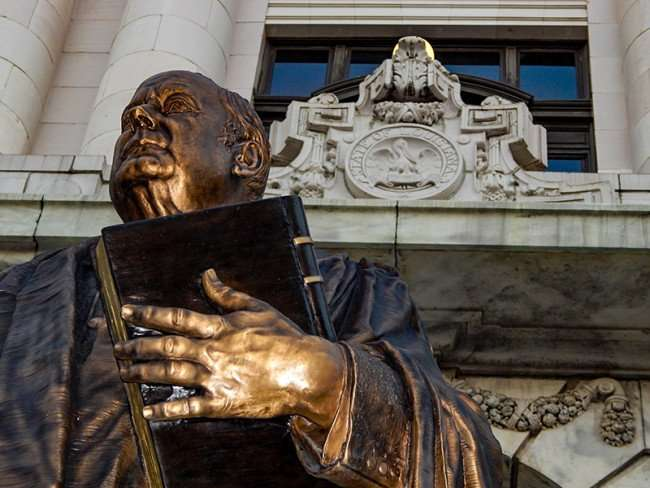 SEPT 14, 2015 - Statue of Edward Douglas White Chief Justice of Louisiana holding book on Royal Street in New Orleans, LA/photonews247.com