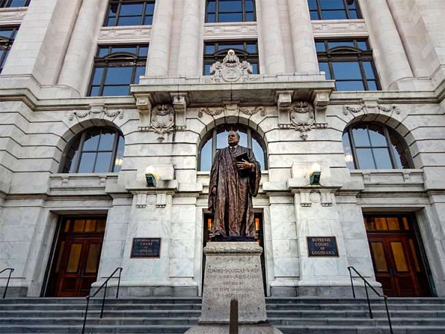 SEPT 14, 2015 - Statue of Edward Douglas White Chief Justice of Lousiana on steps of Courthouse on Royal Street in New Orleans, LA/photonews247.com