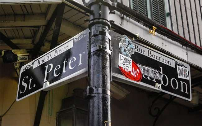SEPT 14, 2015 - Street pole with St Peter Street and Bourbon Street signs with EarthCam in background on building in the French Quarter neighborhood in New Orleans, LA/photonews247.com