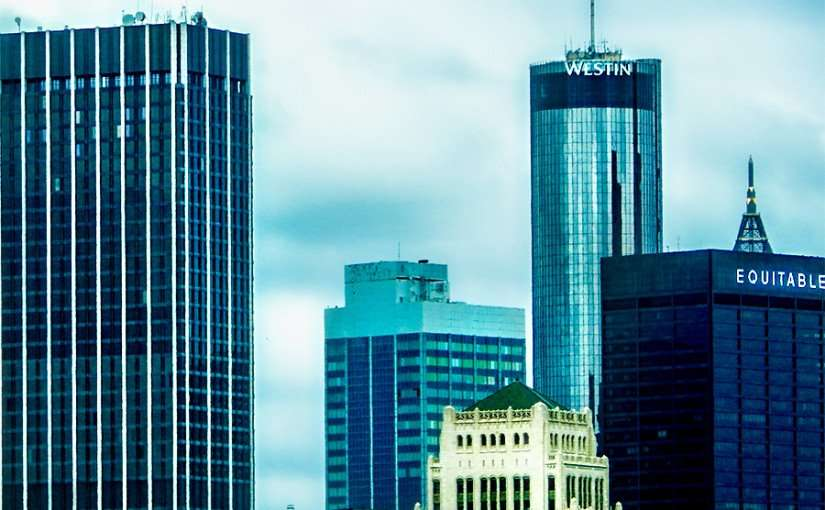 OCT 05, 2015 - Westin Peachtree Plaza Hotel, round glass tower next to Equitable building in Atlanta, GA/photonews247.com