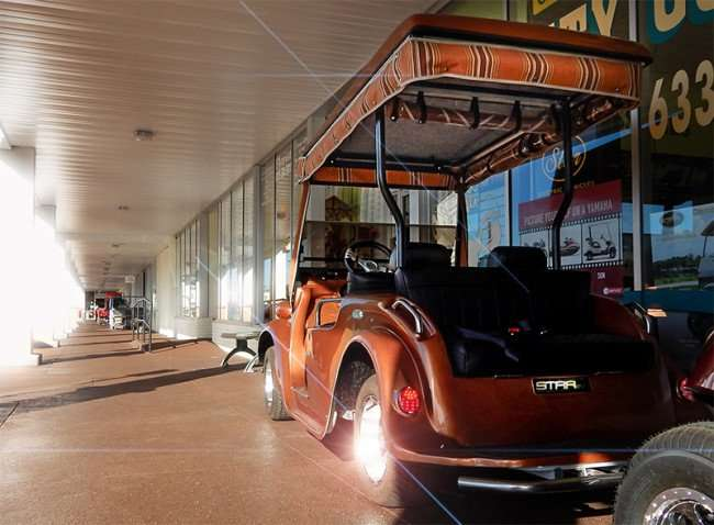 NOV 6, 2015 - 2016 Roadster Star Golf Cart liquid-copper color on sidewalk outside of Sun City Center Golf Carts in Sun City Center Plaza/photonews247.com