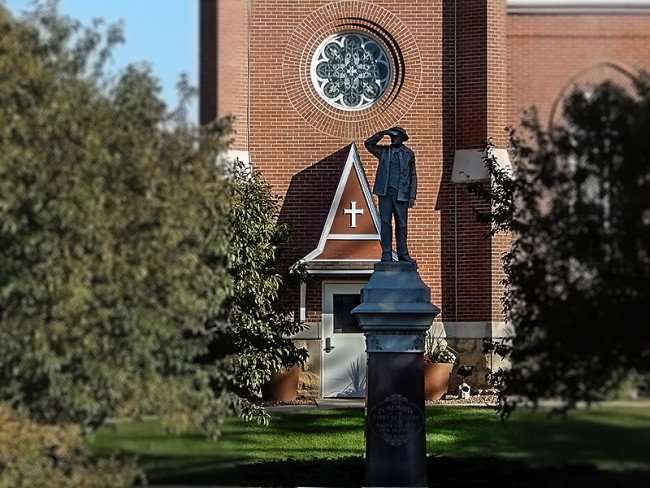 """OCT 10, 2015 - A Memorial Statue of Man looking away created in 1915 'with plate that reads: """"In Memory Of The First Settlers Of The Swiss Colony New Glarus Aug 16, 1845""""/photonews247.com"""