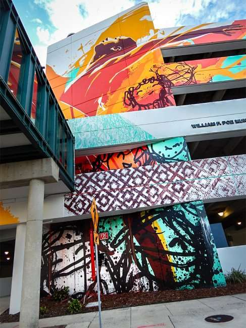 NOV 8, 2015 - Bask & Tes One paint colorfull designs on Poe parking garage along Cass Street in Tampa, FL/photonews247.com