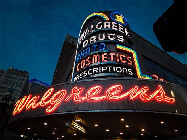 NOV 19, 2015 - Big Walgreens neon sign with lights on at Canal Street, New Orleans, LA/photonews247.com
