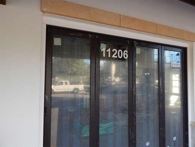 NOV 10, 2015 - Boca Brandon restaurant with address 11206 stenciled on window in Riverview, FL/photonews247.com