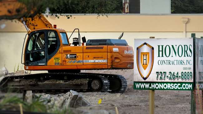 DEC 6, 2015 - DX 300LC Excavator near Honors Contractors Inc sign at Shoppes of South Dale construction site on South Dale Mabry, Tampa, FL/photonews247.com