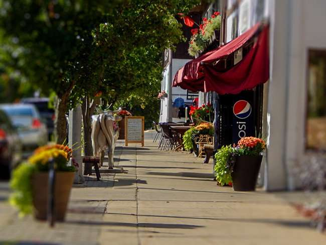 OCT 10, 2015 - Edelweiss Cheese and Pizzaria with sidewalk dining along 1st Street in New Glarus, WI/photonews247.com