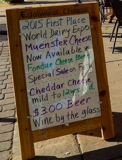 OCT 14, 2015 - Edelweiss Cheese menu on sidewalk in New Glarus, WI/photonews247.com