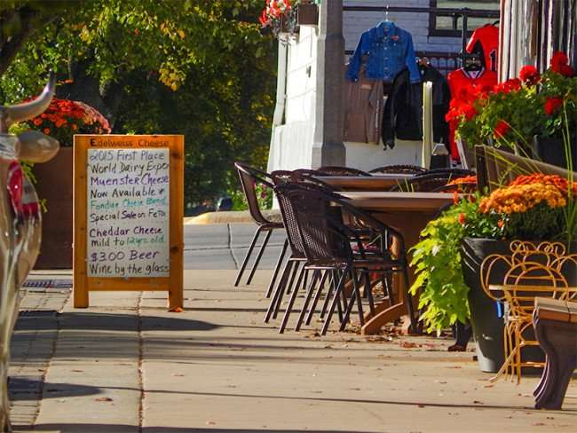 OCT 10, 2015 - Edelweiss Cheese with sidewalk dining along 1st Street in New Glarus, WI/photonews247.com