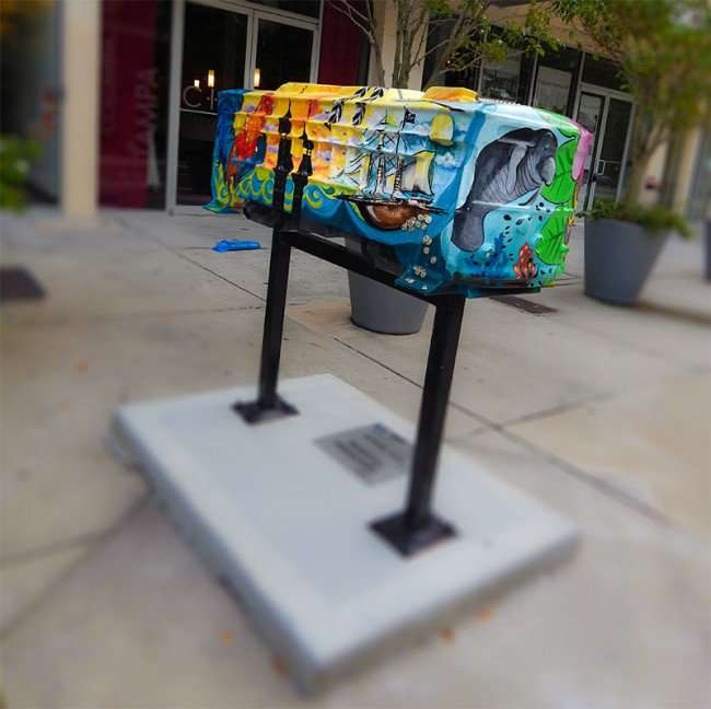 NOV 15, 2015 - Manatee, pirate ship and rooster on Streetcar sculpture by Artists Beth Warmath in Tampa, FL/photonews247.com