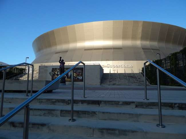 NOV 19, 2015 - Mercedes-Benz Superdome steps leading up to the doors and statue of Tom Benson in New Orleans, LA/photonews247.com