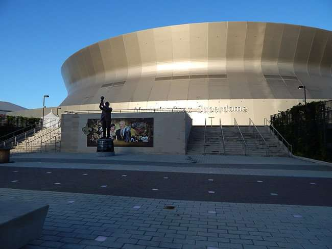 NOV 19, 2015 - Mercedes-Benz Superdome with statue of Tom Benson in foreground in New Orleans, LA/photonews247.com