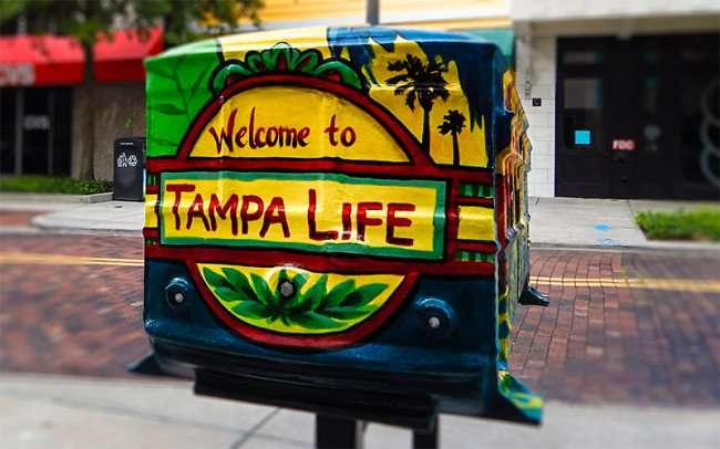 NOV 15, 2015 - Miniature streetcar sculpture on stand, Welcome To Tampa Life by CVS on Franklin St, Tampa, FL/photonews247.com