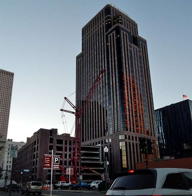 NOV 19, 2015 - OKeefe Parking Garage construction with giant crane next to First Bank in New Orleans, LA/photonews247.com