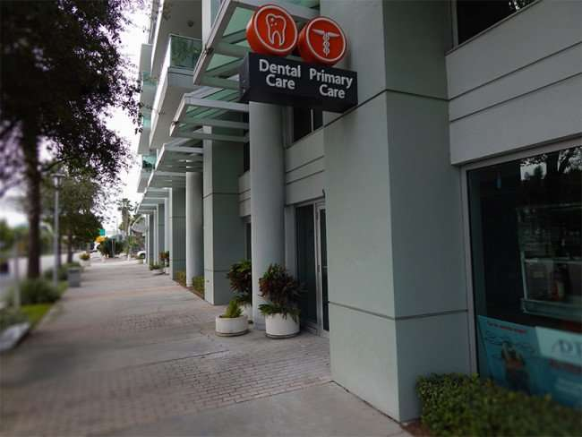 NOV 15, 2015 - OPES HEALTH Dental Care, Primary Care sign on building along Channelside Dr, Tampa, FL/photonews247.com