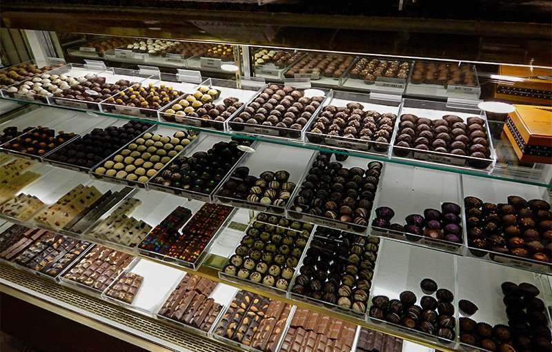 NOV 15, 2015 - Qachbal's home made chocolates and treats in glass cass in Tampa, Fl/photonews247.com