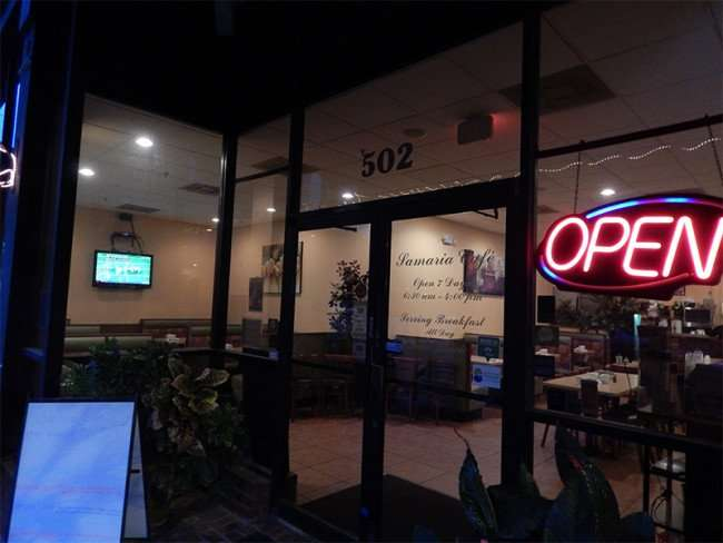 NOV 15, 2015 - Samaria Cafe Restaurant with neon OPEN sign on at front door at dawn in Tampa, FL/photonews247.com