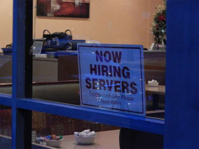 NOV 10, 2015 - Samaria Cafe sign the reads NOW HIRING SERVERS Experienced Only Apply Within on window, Tampa, FL/photonews247.com