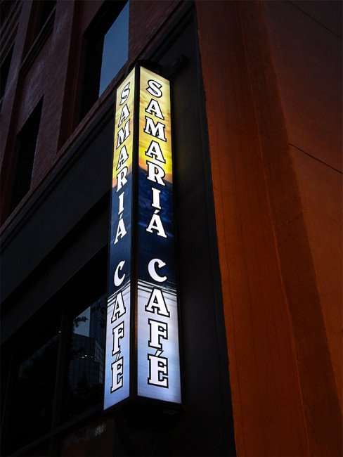 NOV 15, 2015 - Samaria Cafe sign with light on attached to building on Tampa Street/photonews247.com