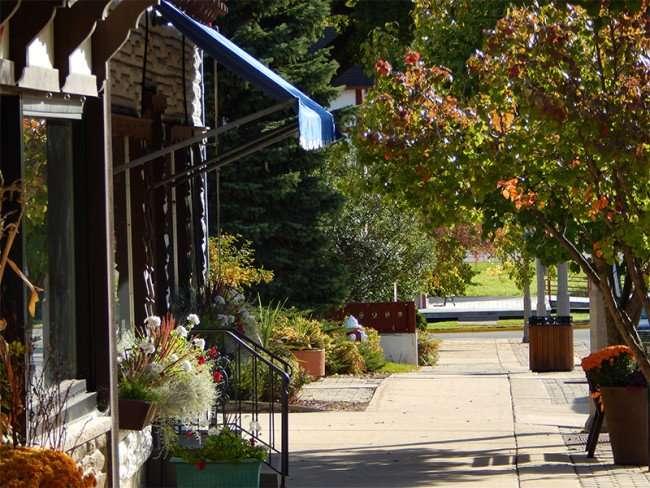 OCT 10, 2015 - Shops along sidewalk of 5th Street in New Glarus, WI/photonews247.com